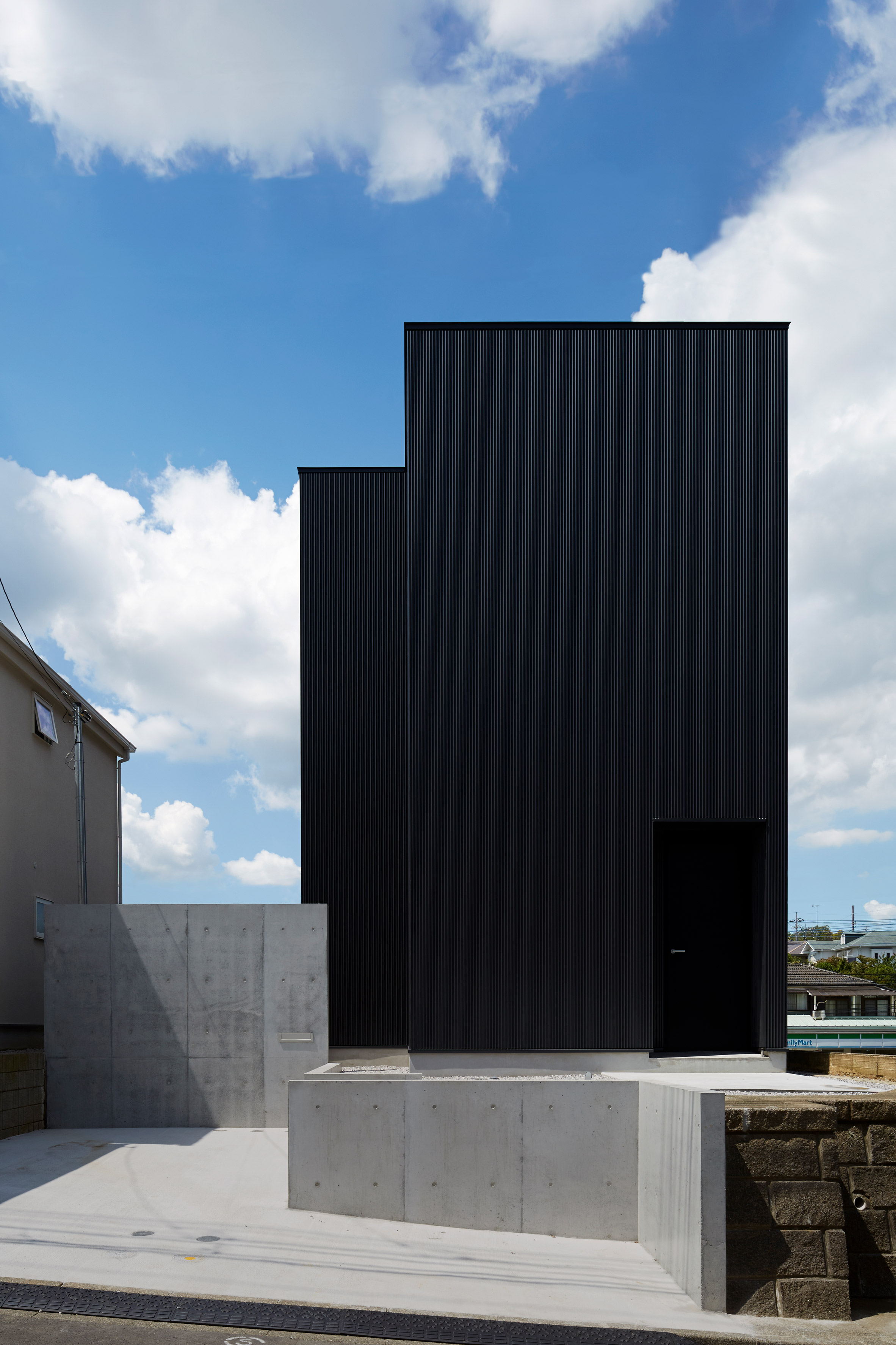 Black corrugated metal encases loft-inspired interiors of Tokyo house by TakaTina