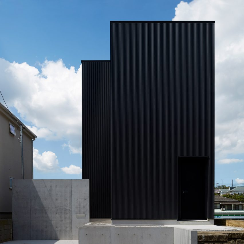 Black corrugated metal encases loft inspired interiors of for Minimalist house materials