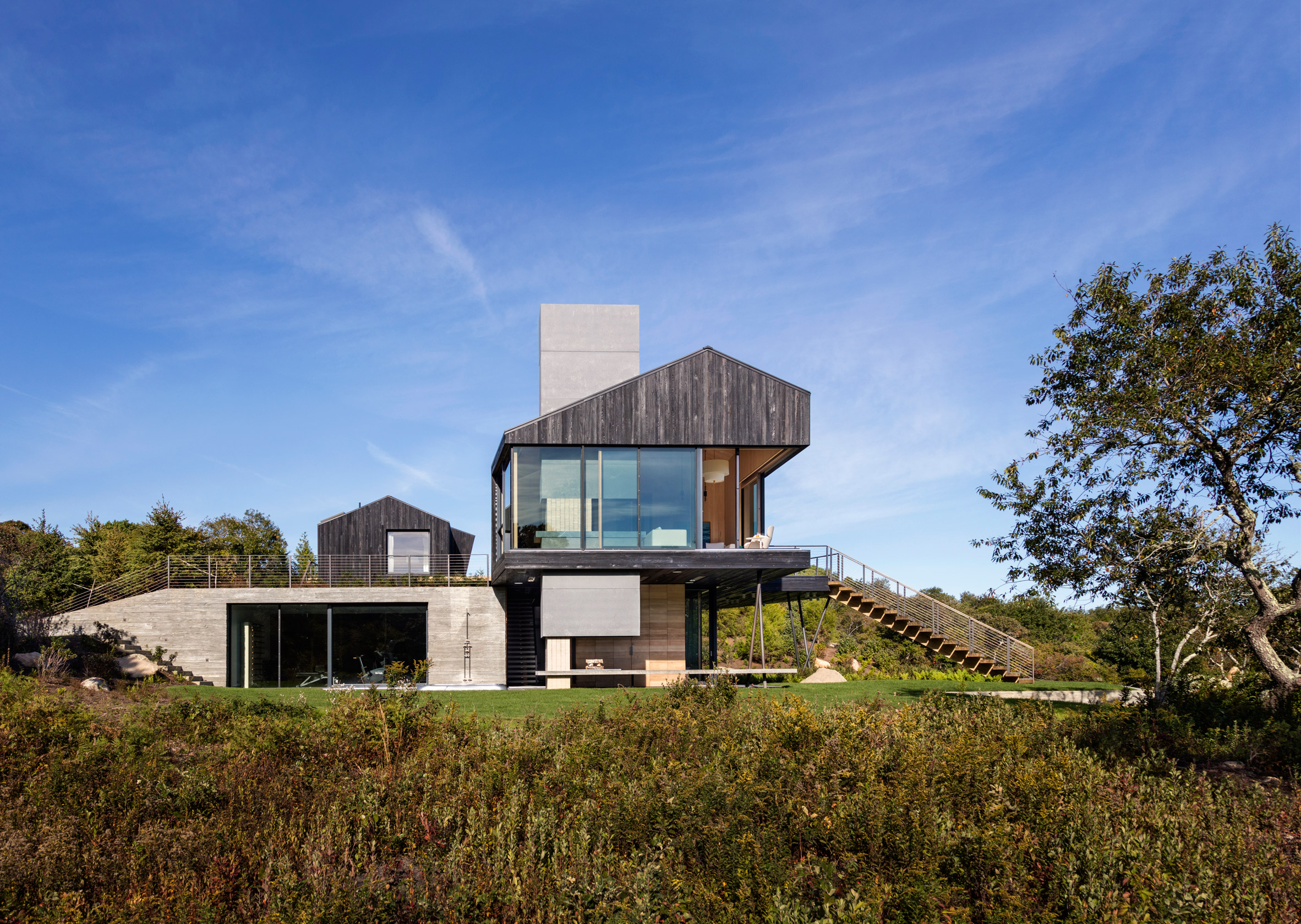 Massachusetts island home is clad in charred cedar and textured concrete
