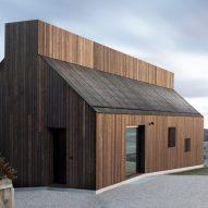 Dekleva Gregorič Arhitekti builds wooden house with chimney-shaped skylight