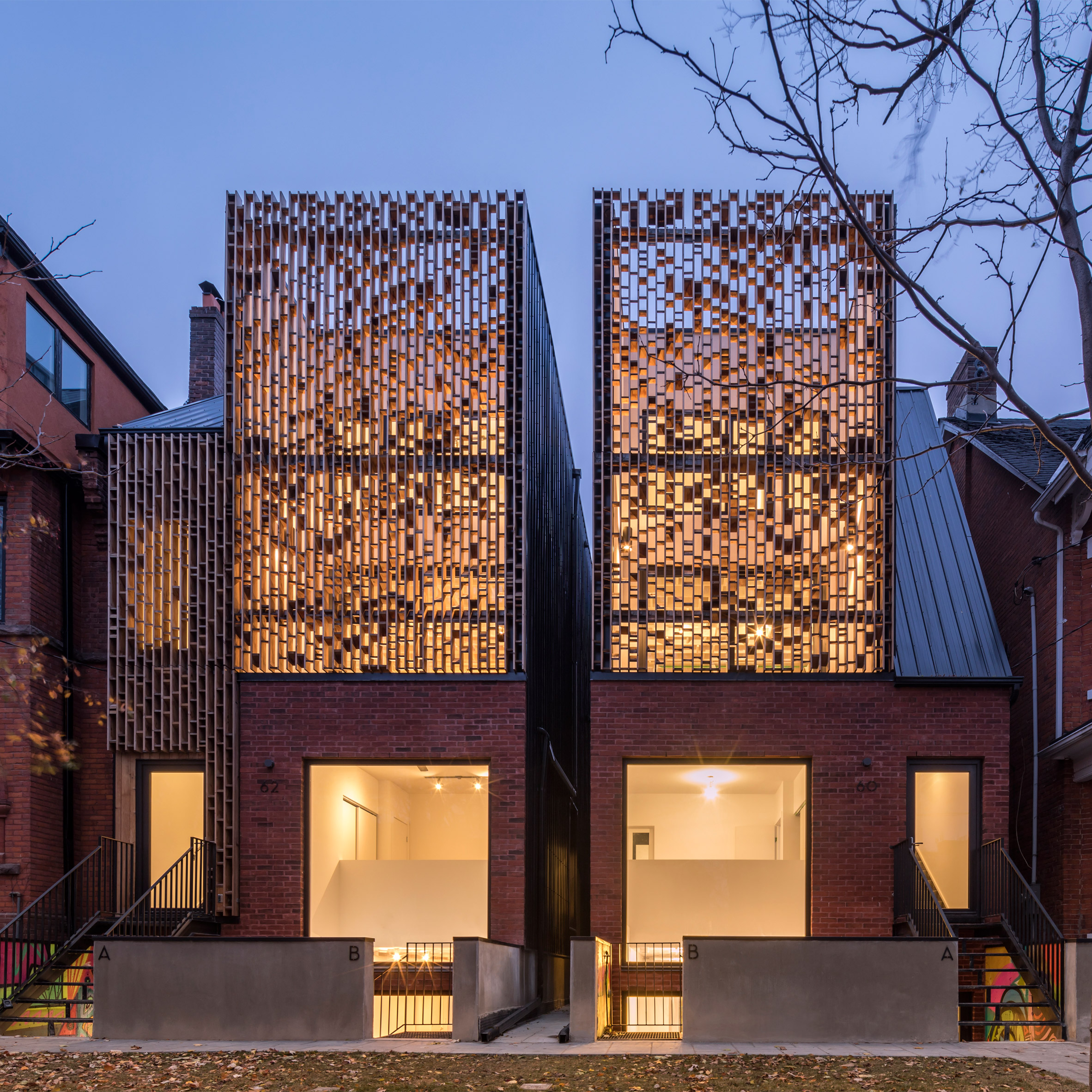Batay Csorba Creates Urban Townhouses In Toronto Faced With Brick And Wooden Screens