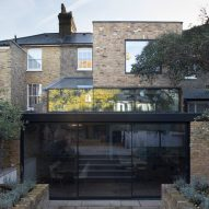 Giles Pike Architects adds stepped glass extension to Victorian house in south London