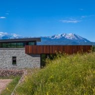 CCY Architects uses weathering steel and locally quarried stones for Colorado ranch