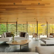 Abundant glazing and wrap-around terraces feature in Vermont home by J Roc Design