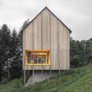 Bernardo Bader perches larch-clad home over concrete plinth in Austrian mountains