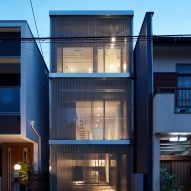 Steel chain curtains cover skinny Osaka house by FujiwaraMuro Architects
