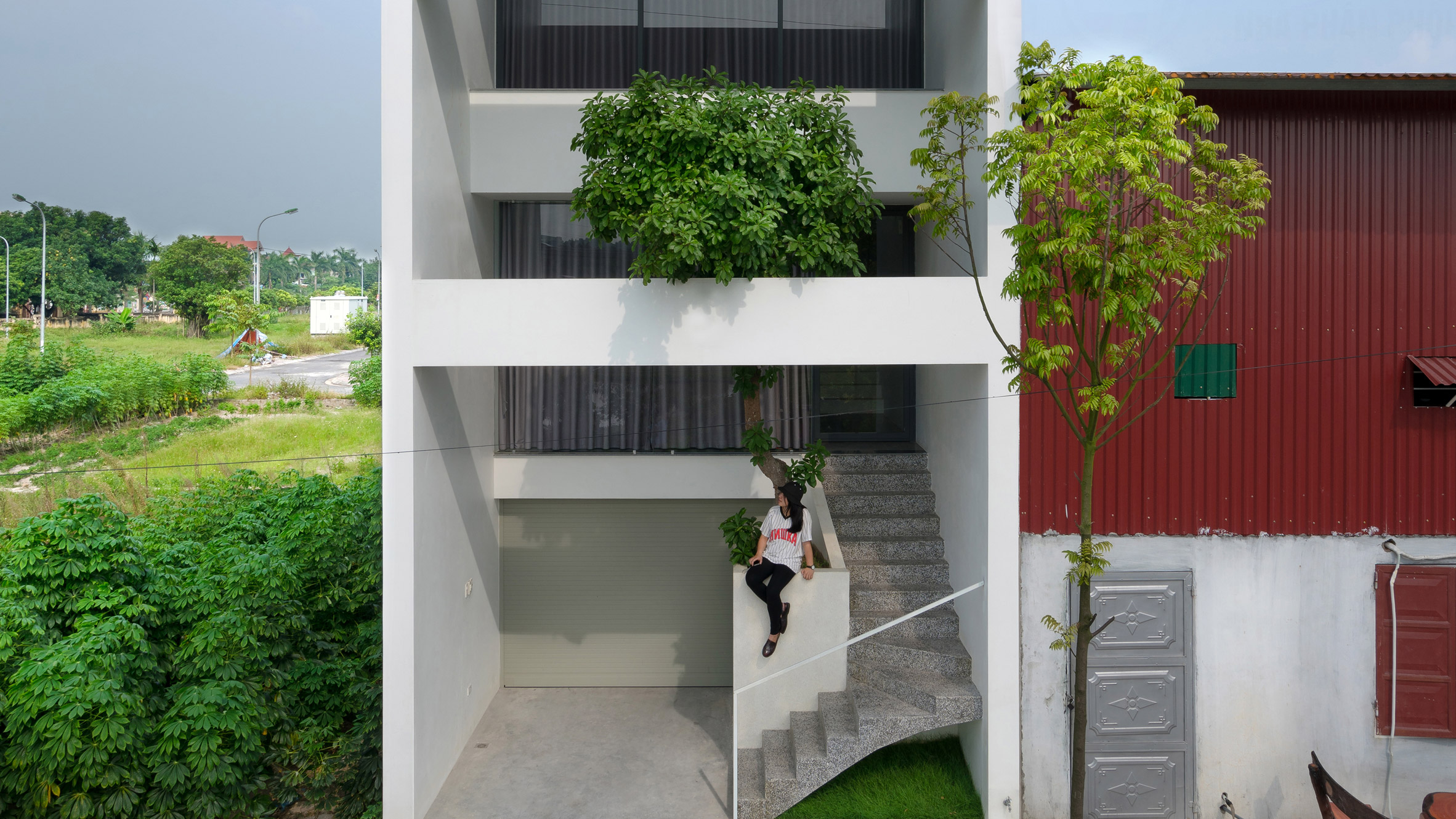 Trees grow up inside narrow Vietnam house by Nguyen Khac Phuoc Architects