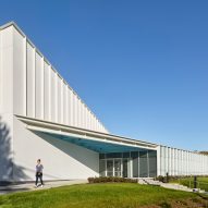 Glass facade invites participation at New Jersey community centre by Ikon.5 Architects