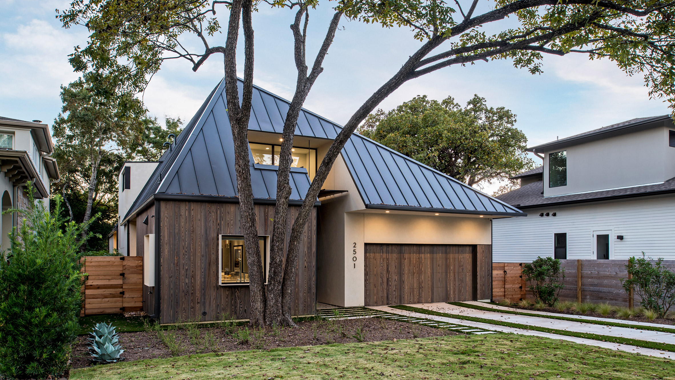 design hound hides second storey of austin home behind faceted roof - Austin Home Design