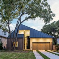 Design Hound hides second storey of Austin home behind faceted roof