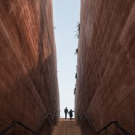 BBGK Architekci uses stained concrete walls to create Katyn Museum inside Warsaw barbican
