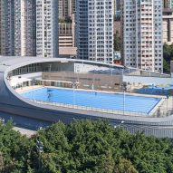 "Farrells completes swimming pool with ""shell-like"" roof on Hong Kong waterfront"