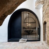 Pitsou Kedem adds white plaster and black iron surfaces to vaulted Jaffa apartment