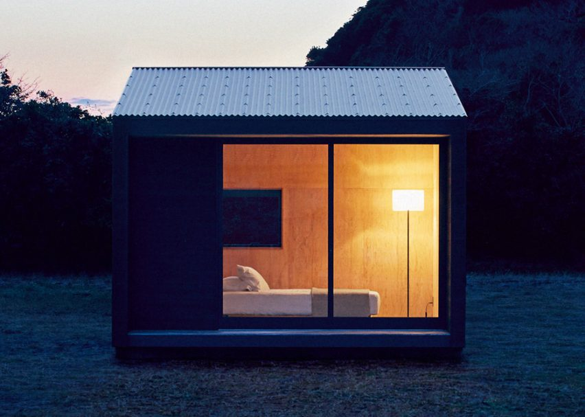 Muji to sell tiny blackened timber prefab huts for £21 000