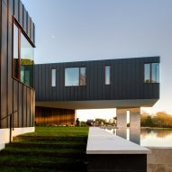 Office of Architecture elevates zinc-clad Hamptons home above a floodplain