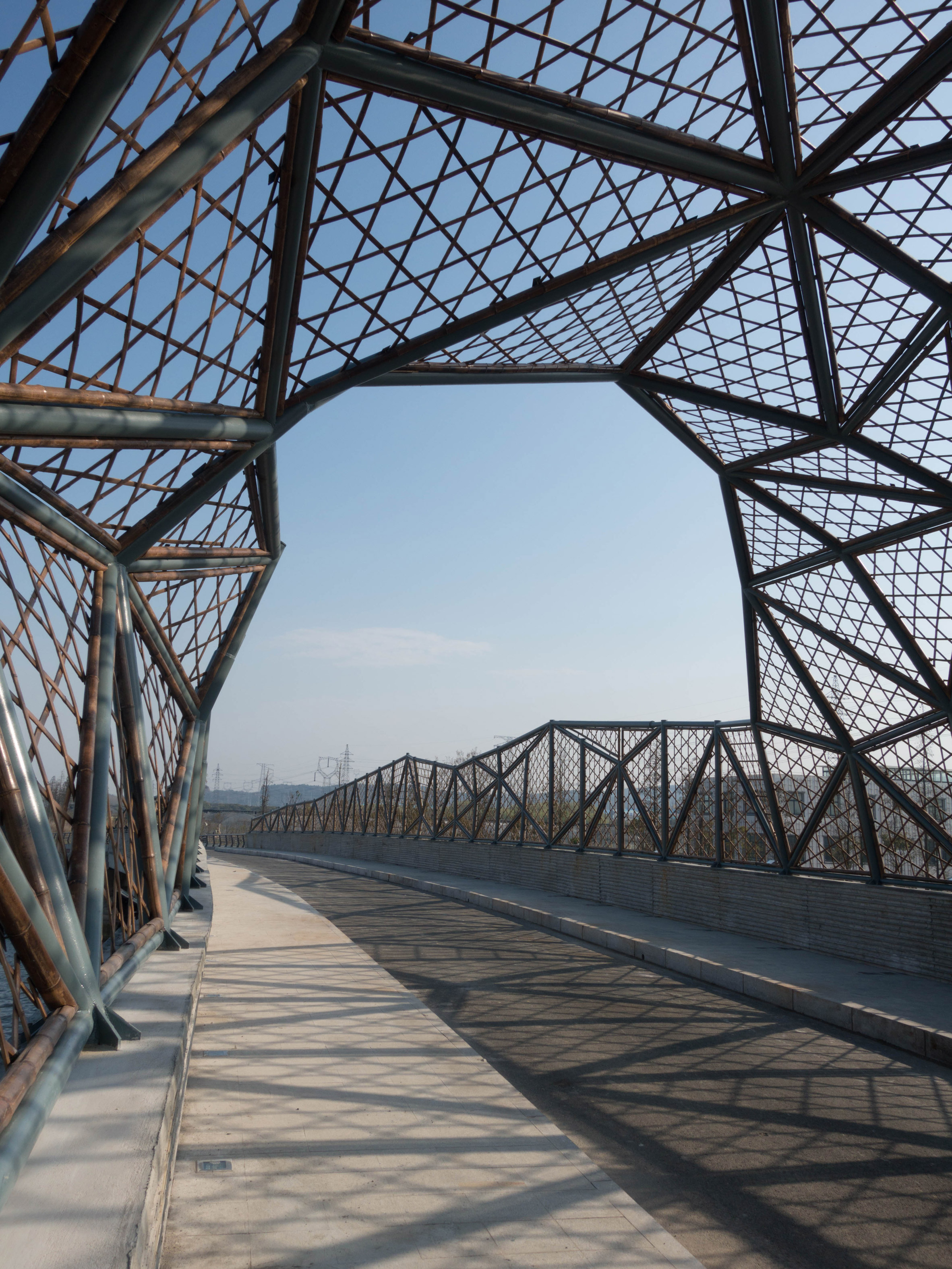 Latticed bamboo bridge by Mimesis Architecture Studio references Jiangsu's craft traditions