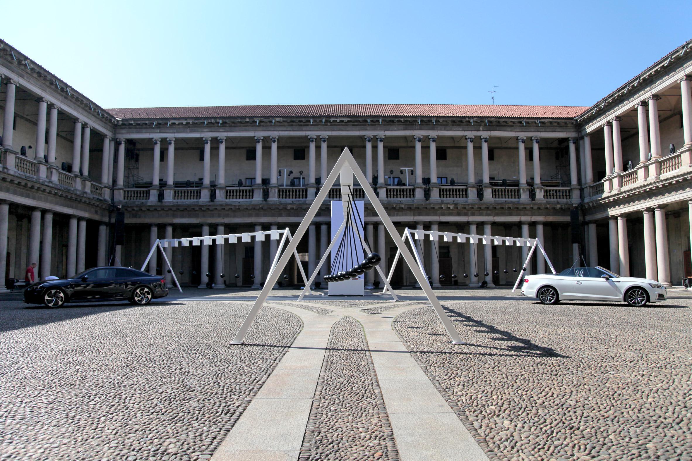 Yuri Suzuki installs giant pendulums in courtyard of Milanese seminary