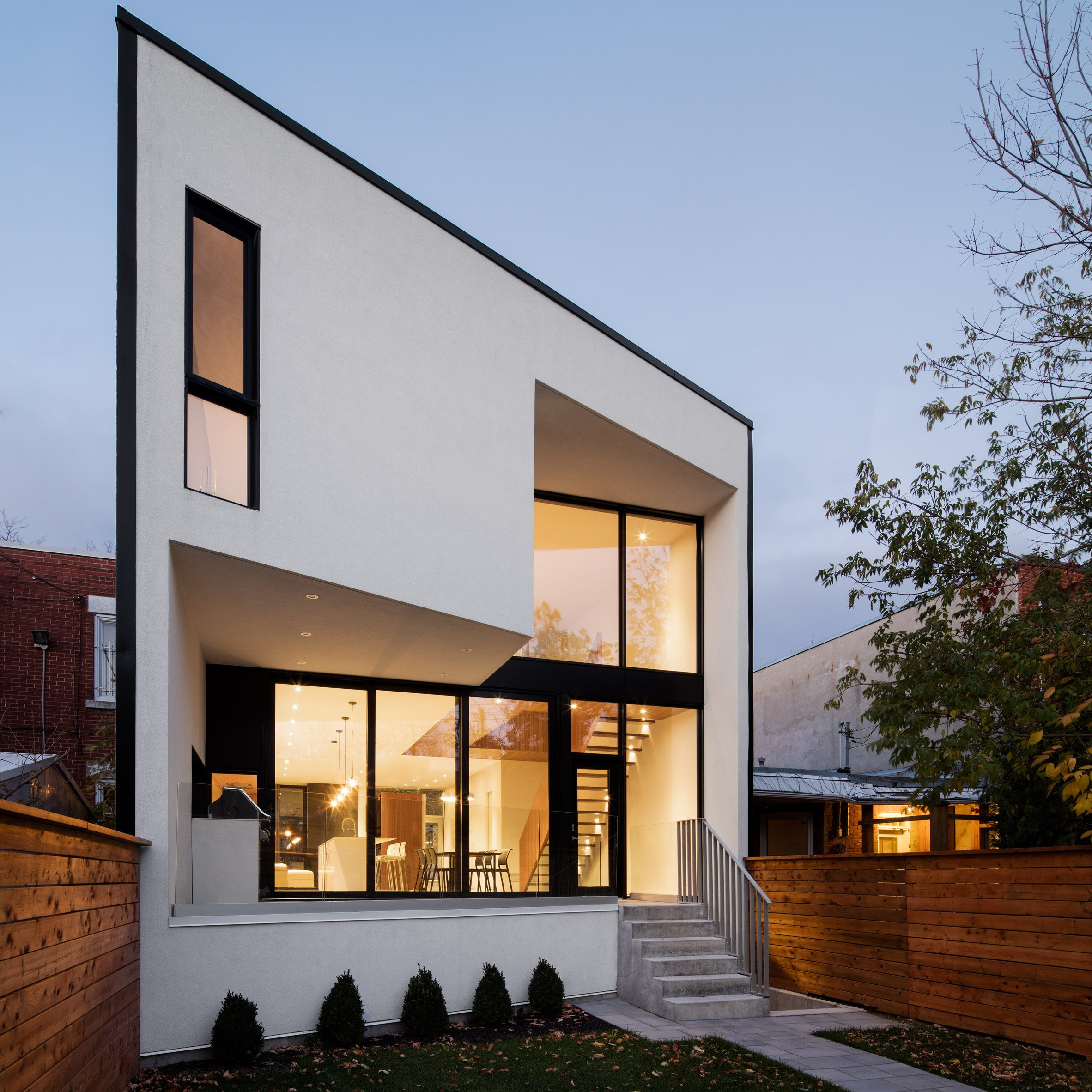 Architecture Microclimat builds minimal terrace house in traditional  Montreal neighbourhood
