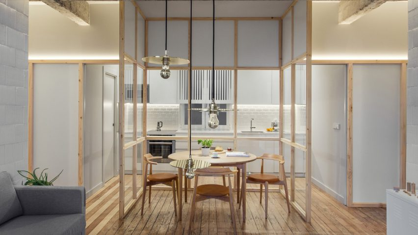 A kitchen with a glass partition