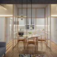 Concrete girders and glass partition walls carve up this broken-plan apartment in Bilbao