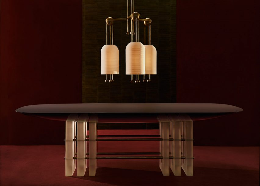 Segment dining table and Lantern pendant by Apparatus