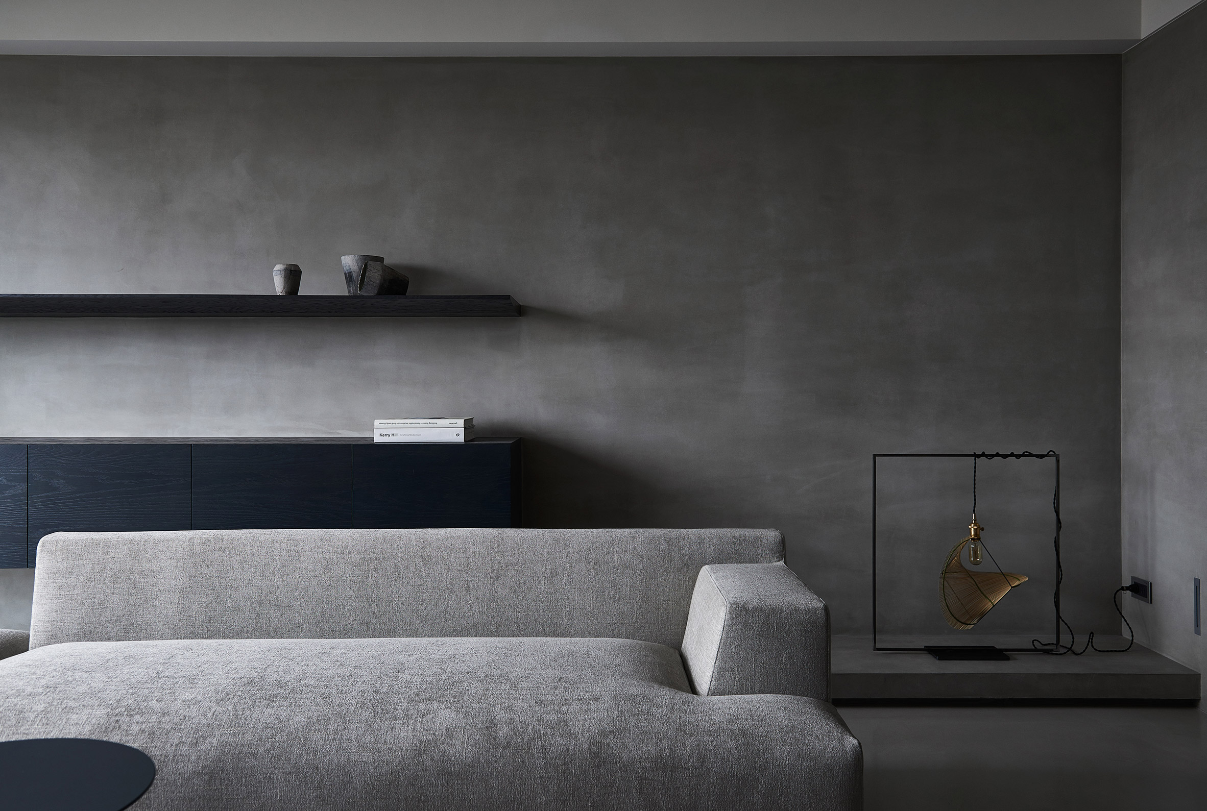 Shades of grey decorate sombre luxury apartment in Taiwan
