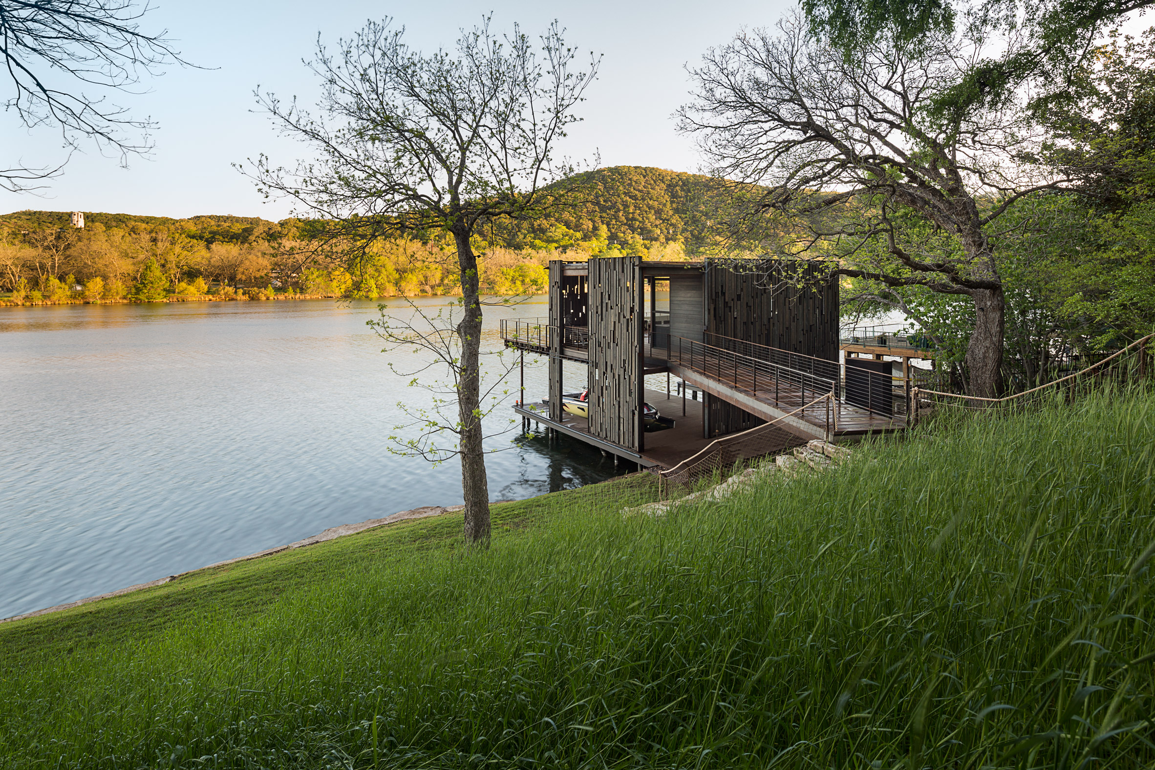 Andersson-Wise assembles new and salvaged materials into rustic Austin boathouse