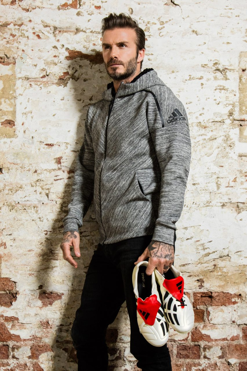 Former Manchester United and Real Madrid midfield David Beckham holding the new Predator Mania boots.
