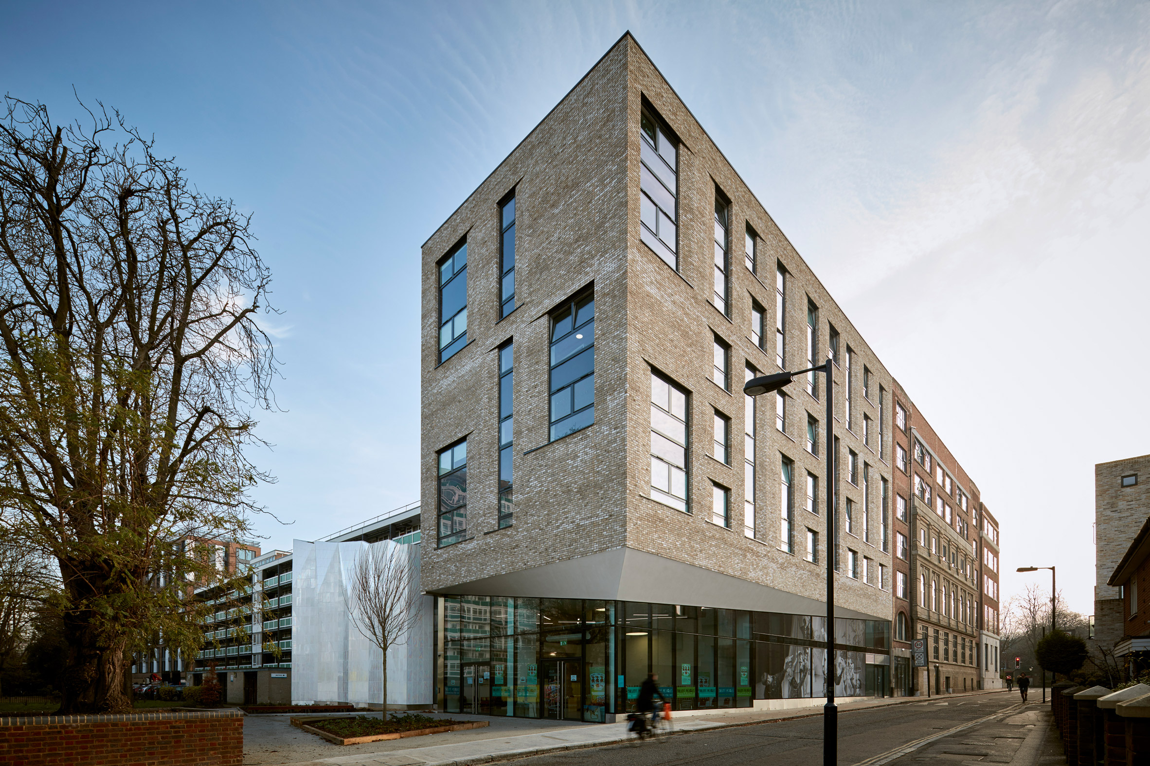 Jestico + Whiles converts town hall into student halls with ir...
