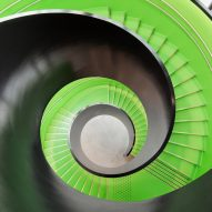 Reiulf Ramstad Arkitekter's Cultural Center Stjørdal features a lime green spiral staircase