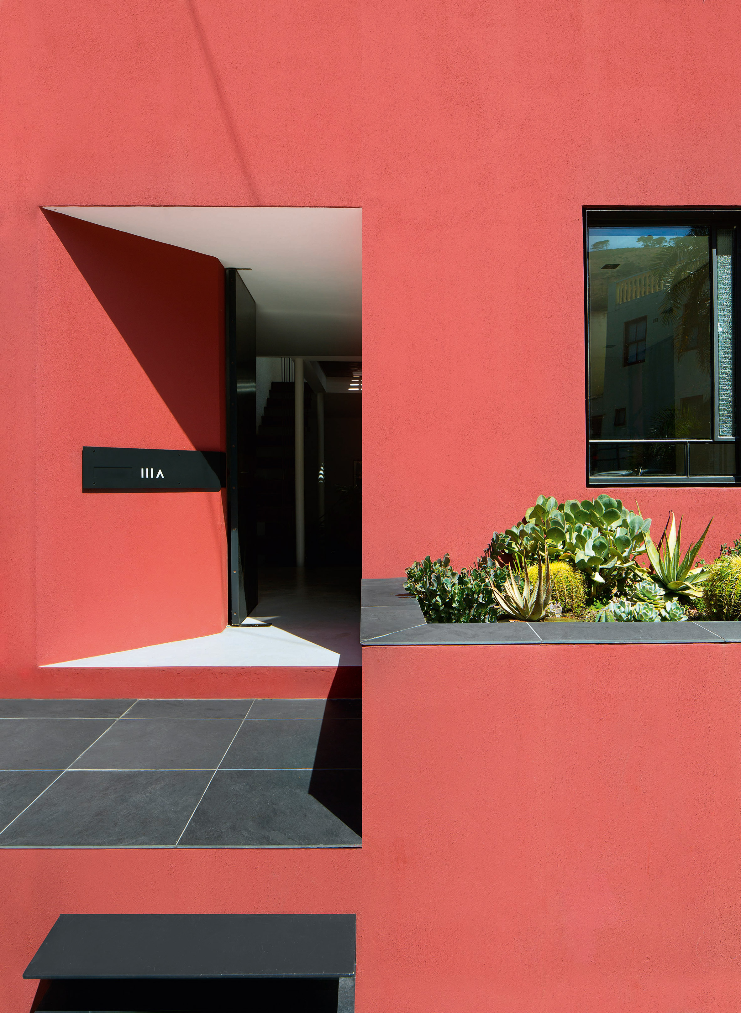 Pink Cape Town house by The Fold Architects features rooftop pool and vertical garden