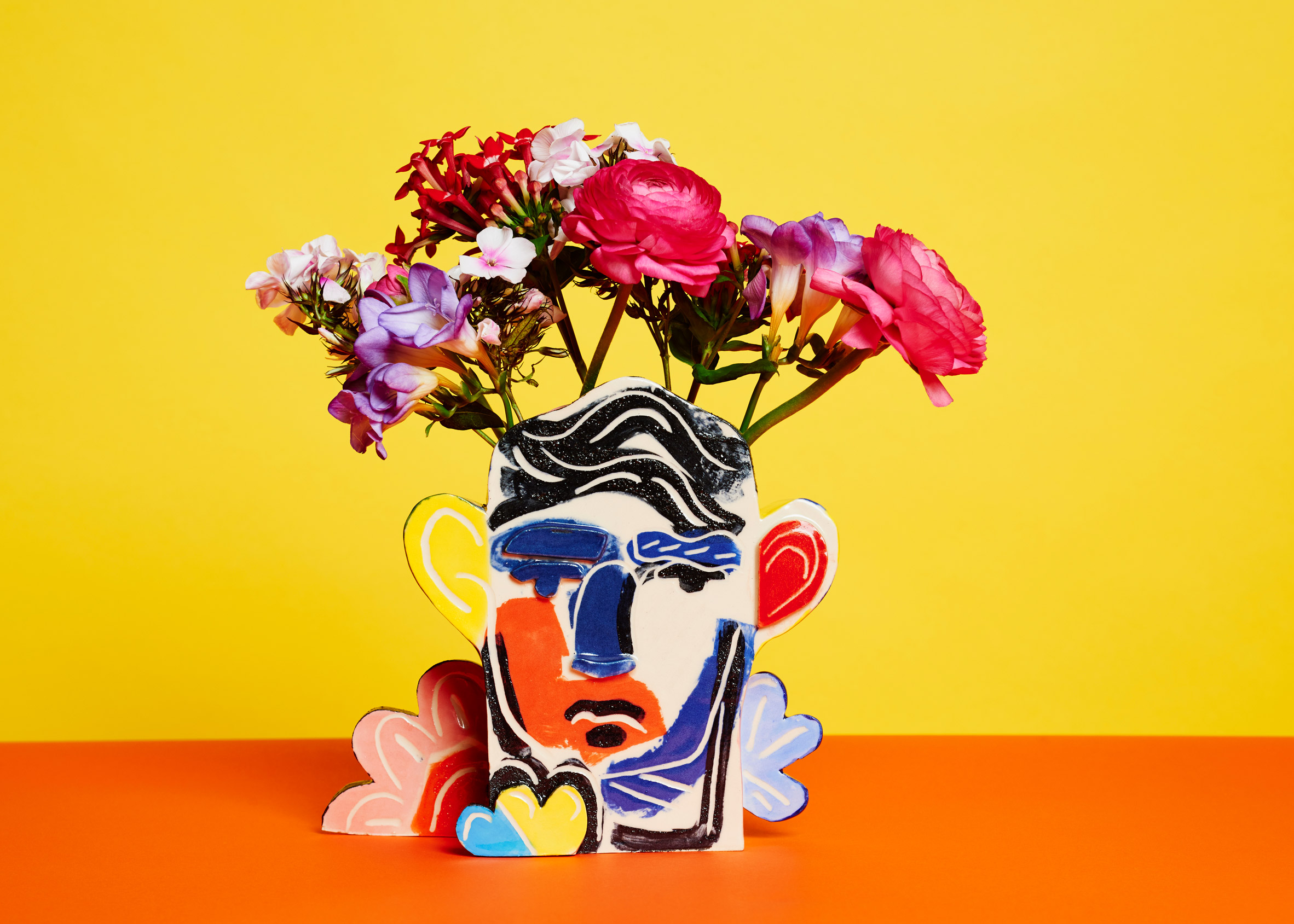 John Booth hand paints abstract faces for Tributes ceramics collection