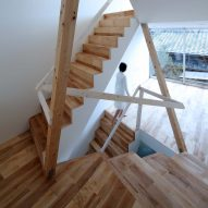 Timber frame projects into rooms and stairwell of Alphaville's compact Kyoto home