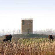 Rammed-earth tower by De Gouden Liniaal Architecten overlooks the Maas river