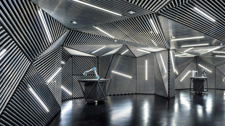 ministry of design creates robot training facility lined with metal rh dezeen com