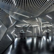 Ministry of Design creates robot training facility lined with metal and tube lights