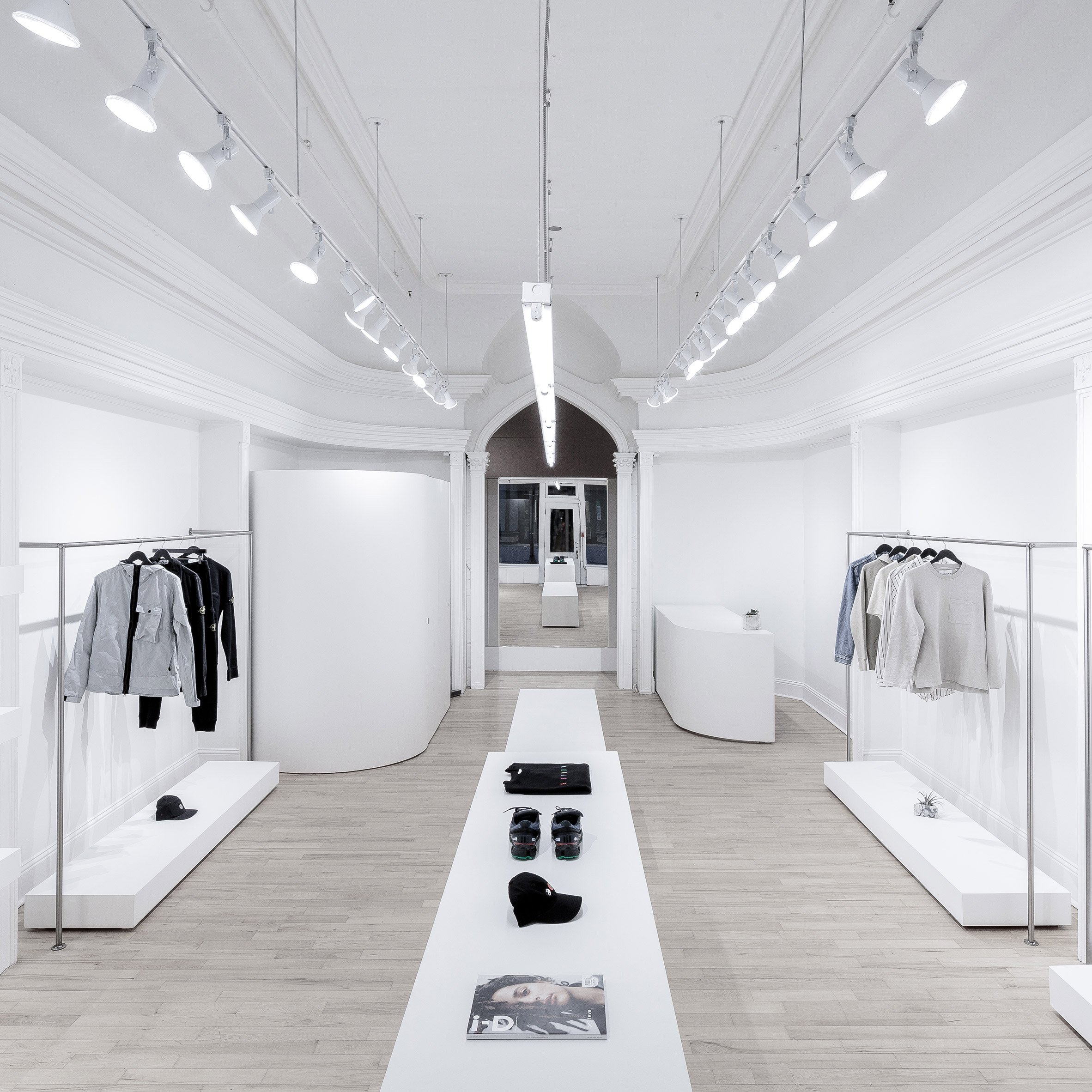 boutique architecture and interior design  dezeen - omar gandhi architect creates minimal fashion store for rchmnd in halifax