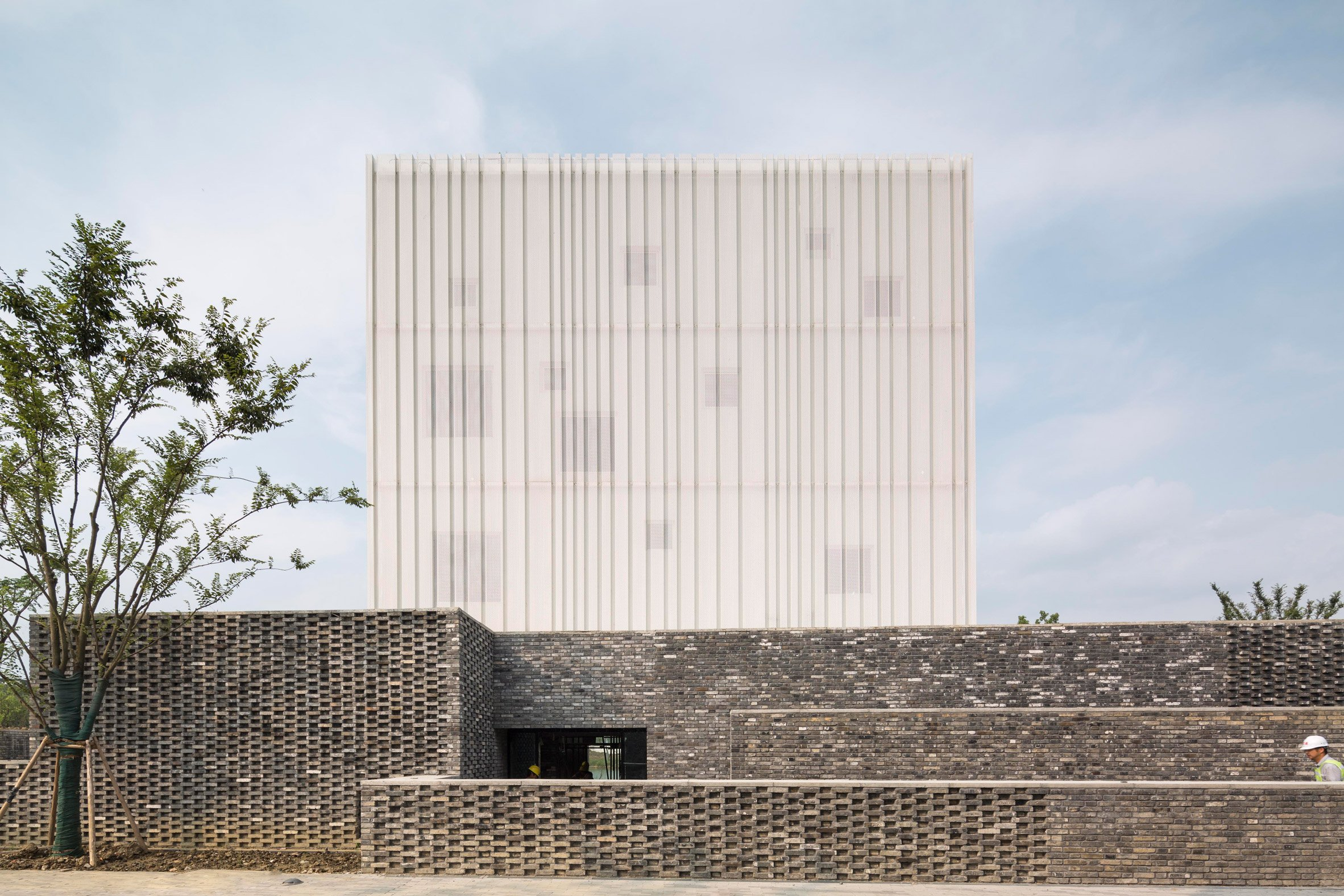 Neri&Hu's Suzhou Chapel combines textured brick base with ethereal white cube