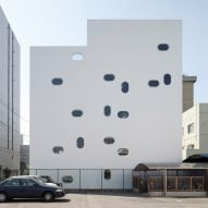 Oblong windows puncture concrete office block by Yoshihiro Kato Atelier