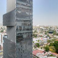 Angled louvres shade glass skyscraper in Guadalajara by Sordo Madaleno Arquitectos