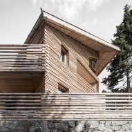 Bergmeisterwolf reinterprets the traditional log cabin with Twisted House apartments
