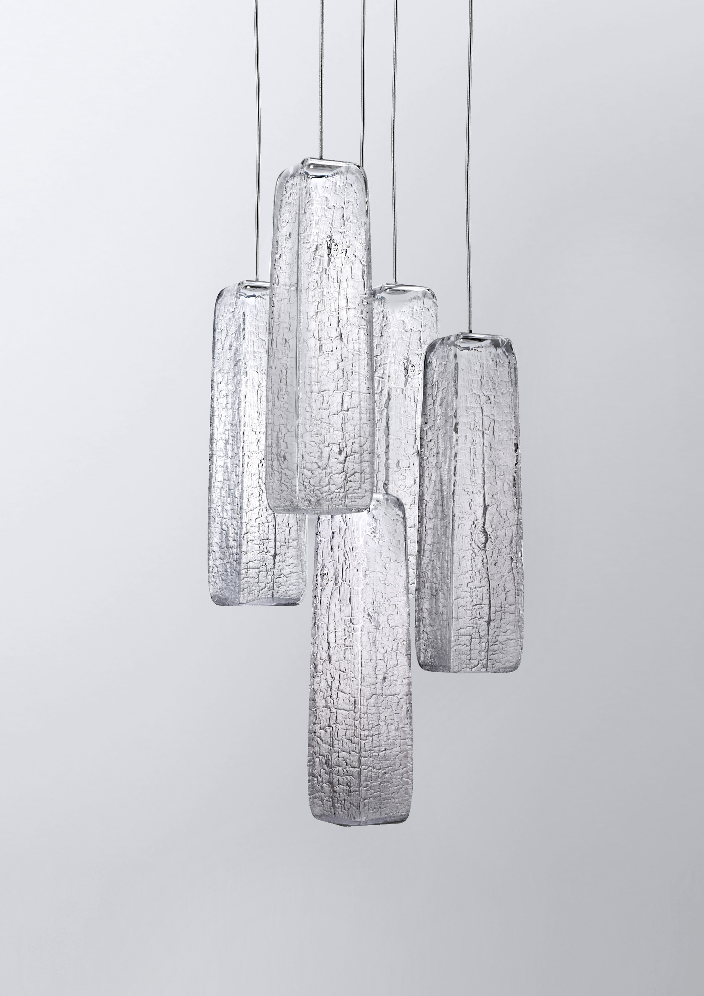 Kengo Kuma burns woods to create crackled glass lighting for Lasvit