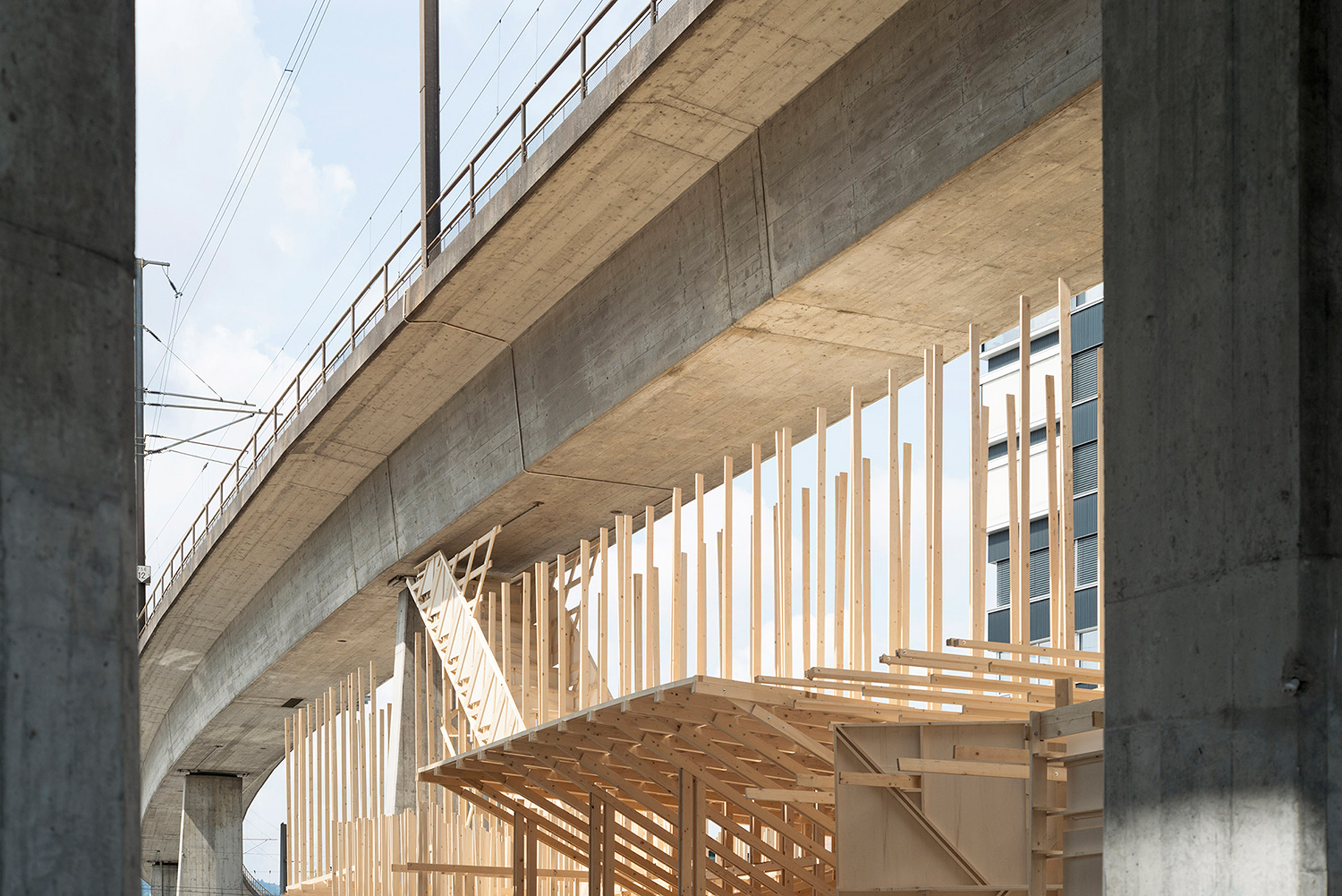Swiss architecture students design and build wooden events pavilion beneath Zurich overpass