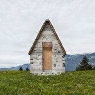 Innauer-Matt Architekten's tiny Alpine chapel features a steep shingle-clad roof