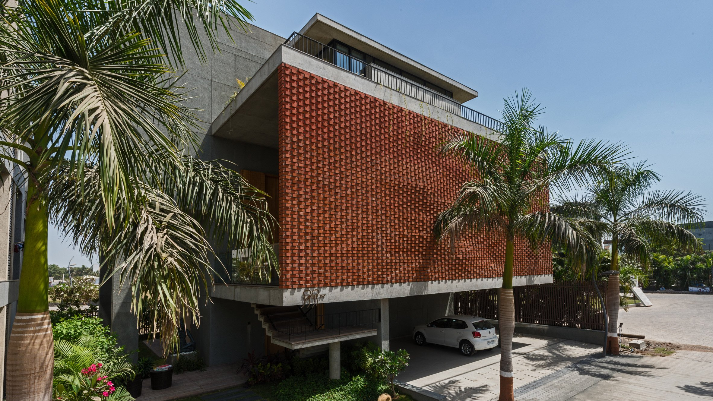 Exceptional Rippling Red Brick Facade Shades House In Surat By Design Work Group
