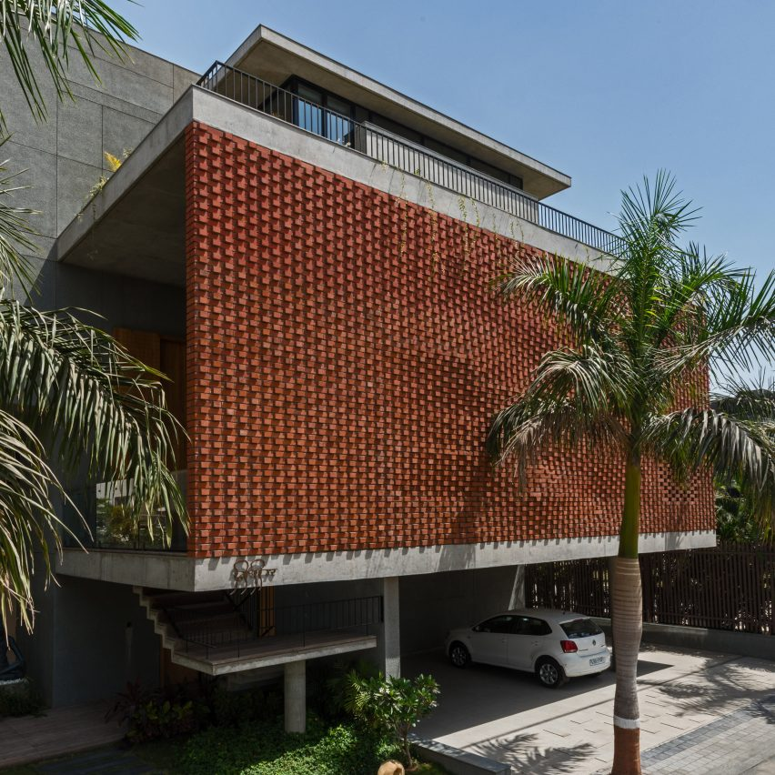 Rippling red brick facade shades house in surat by design for Architecture design of house in india