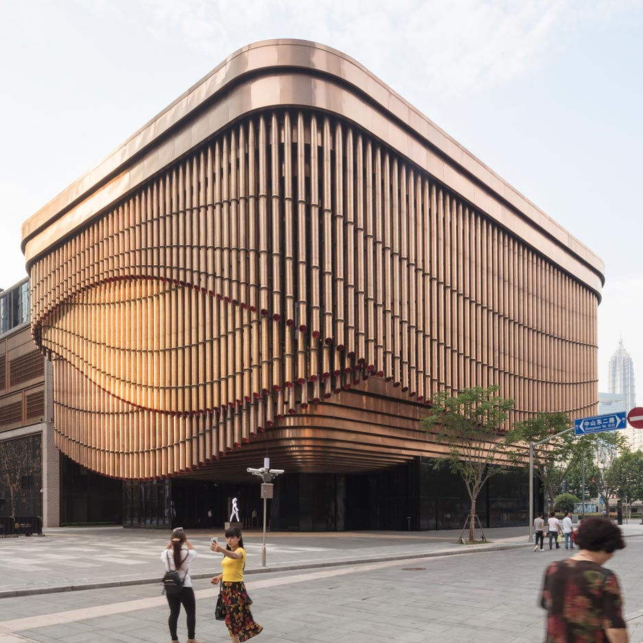 Foster and Heatherwick build Shanghai arts centre with curtain-like
