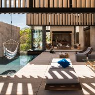 Slatted marble walls shade Casa Chaaltun pool deck in Mexico
