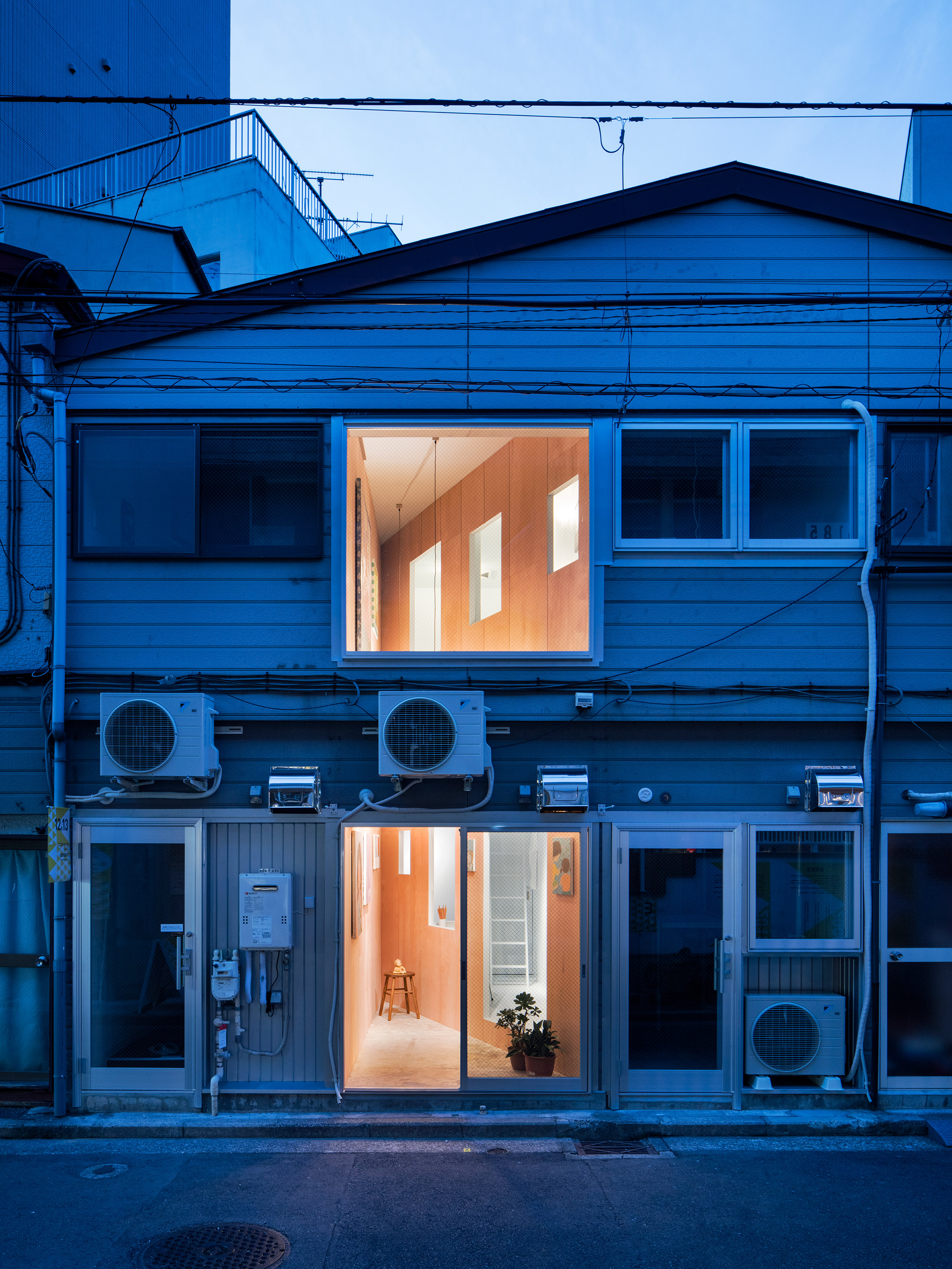 Sex shop converted into tiny Japanese art gallery by Persimmon Hills Architects