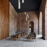 Max Dudler creates restaurant inside Heidelberg Castle's sandstone-walled saddle room